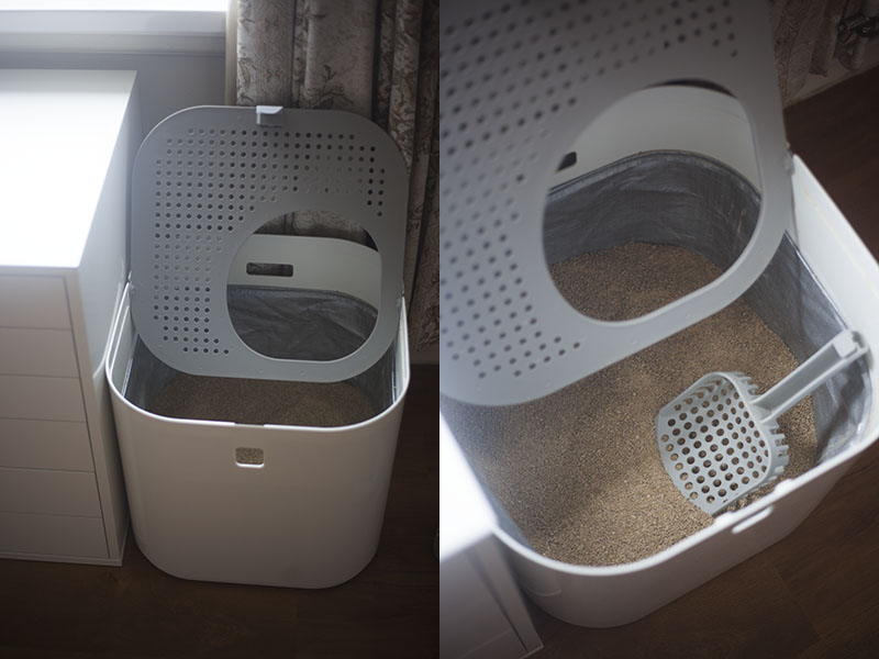 cleaning-out-modkat-litter-box-top-entry-lift-lid