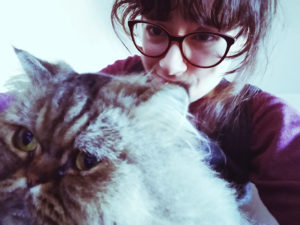 persian-cat-snuggling-with-girl-selfie